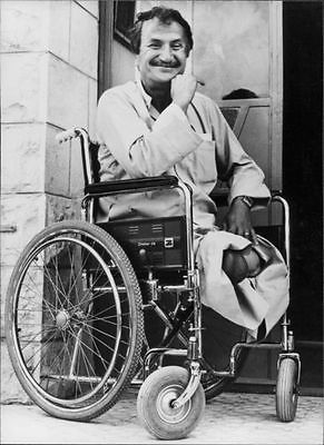 vintage-photo-of-bassam-shakaa-on-wheelchair-b94389b473267b7d9fa41d2f911aff25